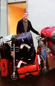 Matthew is clearly thrilled about shepherding my copious luggage.