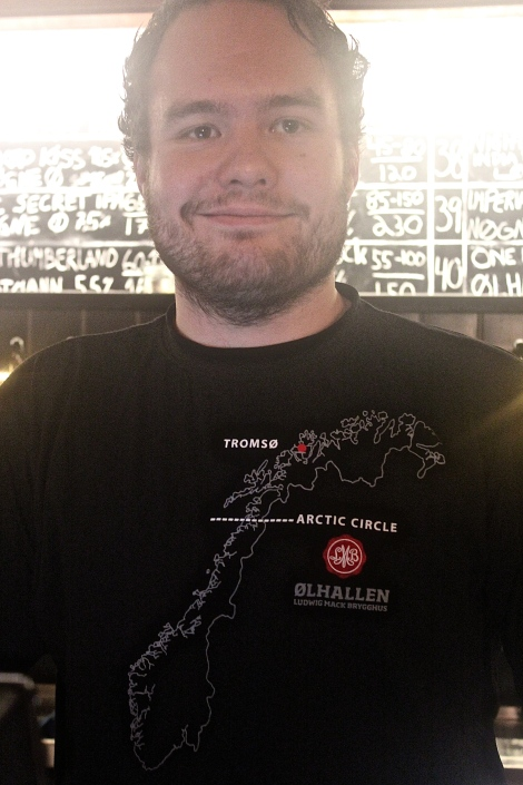 Our bartender's nifty shirt tells you where Tromsø is located.