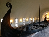 Looking down into the Oseberg, you can see the deck, gangway, rudder/tiller, a bailing bucket, and 15 pairs of oar holes. The mast itself held a single sail measuring 968 square feet (90 square meters), meaning that the boat could have reached speeds of more than ten knots. The ship itself measures a little over 70 feet (21.5 meters) in length and about 16 feet (five meters) in width.