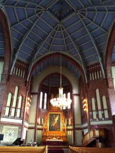 The ribbed ceiling, Hollenbach organ, and altarpiece by Christen Brun.