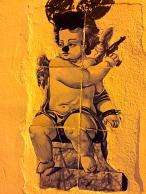 "Allegorical figures from the Bible or Greek mythology were also en vogue. I kinda love the graffiti artist's ""modernization"" of this tile."