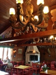 Note the carved chandelier. The number of trophies lining the rafters attests to the owner's son's many moto-cross and road rally championships over the years.