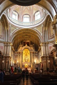 But the interiors are gussied up with trompe l'oeil paintings and gilded altars.