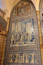 The azulejos are 18th-century designs that mimic the blue-and-white delft tiles of the Netherlands. Each tiled panel tells a story from the Bible or church history.