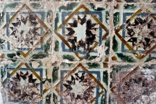 The earliest tiles were Moorish-styled mosaics, with each color being represented by a single glazed piece inserted into an intricate pattern.