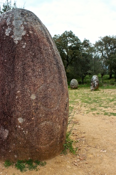 Note the circles engraved on the stone. These may function as clan symbols.
