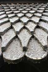 The shingled, tarred roof resembles the scales on a dragon.