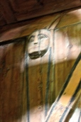 """During the Reformation, most representations of saints were cut away, but a few escaped """"decapitation,"""" as this saint-headed column capital reveals. (Sorry for the blurry interior photos -- the lack of light makes it hard to get a good pic, and use of a flash is discouraged.)"""