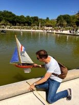 Matthew prepares to launch his sailboat.