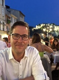 Matthew at Le Calendal, one of the wonderful restaurants along the harbor. The 12th-century fortress / castle at Cassis can be seen in the background.