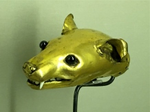 Who doesn't need a gold weasel with gemstone eyes and ivory teeth?