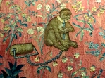 "This little monkey isn't thrilled about being chained in his ""millefiori"" background, which contains dozens of accurately detailed flower species."