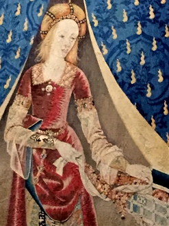 Note how the changes in thread color give a 3-D effect to the folds in her sleeves and the curve of her bodice.