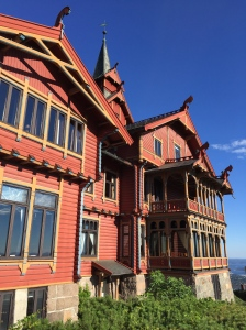 The Dragon-style Holmenkollen Hotel on a sunny day.