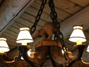 Wooden bears survey the dining room from their chandelier perches.