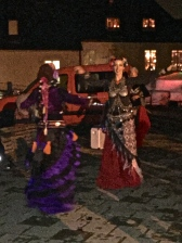 Belly dancers try to wriggle between the raindrops.