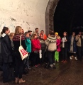 A choir of Norwegian sweaters occupies a tunnel.