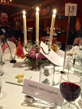 "The pretty table settings, complete with a commemorative ""Bloodaxe"" mug. (Each year, the guards get to pick a mug motif, so this year they went Norwegian.)"