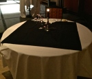 A table draped in black with a single place setting honors Marines killed or missing in action.