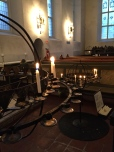 I love the prayer candles in Norwegian churches. They look a bit like armillary spheres. Note the smaller version for the kiddies to use.