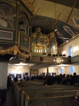 """Much of the church interior is Baroque. The """"sky box"""" on the left is where the royal family sits during services."""