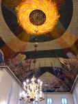 The ceiling of the Domkirke is covered in modernist paintings by Hugo Louis Mohr.