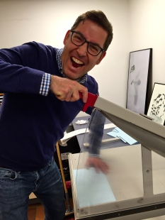 Matthew's a bit too enthusiastic with the guillotine-like paper cutter.