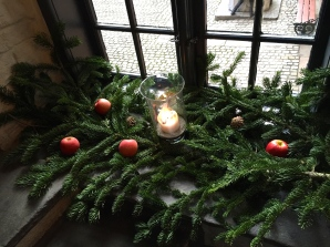 Evergreen branches, apples, and candlelight seem to be standard Norwegian holiday decorations.