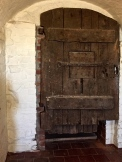 "The door to the dungeon and the ""Witch's Pit."""