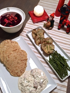 Herring, lefse, caraway-drizzled beets and other root veggies, along with beans and cheesy potato skins.