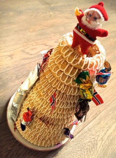 The Kransekake is decorated with candy and British-style crackers that pop open with a bang to reveal trinkets and jokes (in Norwegian) inside.