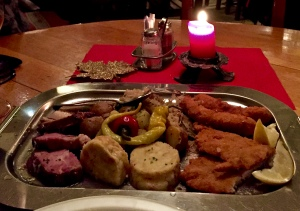 Our overladed platter dished up a little bit of everything: wiener schnitzel, port, dumplings, sausages, and chicken.
