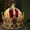 "The Imperial Crown of Austria was originally made for Rudolph II (1602) as his ""personal crown."" Since the coronation regalia couldn't leave the then-capital city of Nürnberg, Rudolf wore this one when traveling and on his days off from official duties as Holy Roman Emperor. But lest anyone forget who he was, the crown merges a bishop's miter (to symbolize Rudolph's divine authority) and a Roman emperor's helmet (to symbolize his role as successor to the empire that fell in A.D. 476.)"