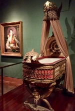 "When Josephine couldn't produce an heir, Napoleon divorced her and married a Hapsburg, who bore him a son. The baby was bestowed the title of King of Rome, and this was his official ""throne-cradle."""