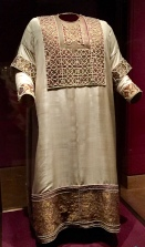 "Called the ""Alba"" for its white color, this coronation robe dates to the 13th century on the outside. However, tests have shown that it covers older garments layered inside. One of these may date back to the 9th century -- perhaps during the reign of Charlemagne."