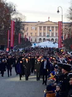 The king, queen, and entire royal family promenaded from the palace to the University's concert hall.