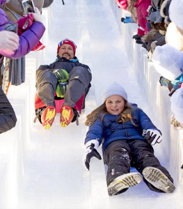 Crown Prince Haakon and his daughter Princess Ingrid Alexandra take to the ice slide. © Rex from Hello! magazine.