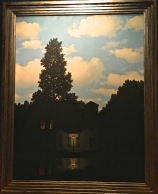 "One of his ""Empire of Lights"" paintings, which hint at the almost ominous air of quiet suburbia."