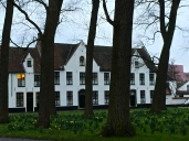 """Note the daffodils just popping up in the tranquil Begijnhof courtyard, where women of the nun-like lay order known as the Beguines once lived. (I can't say that word without thinking of the Big Band tune, """"Begin the Beguine."""" Look it up on YouTube.) Single religious women and Benedictine nuns still live here."""