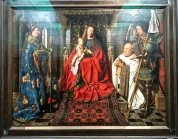 """Jan van Eyck -- often called the world's first and greatest oil painter -- is classified as a """"Flemish Primitives"""" artist. The term simply means that the Flemish (who were the most refined artists in the 1400s) hadn't yet perfectly mastered 3-D perspective. This painting, entitled """"Mother and Child with Canon Joris van der Paele,"""" is van Eyck's masterpiece, painted in 1439."""