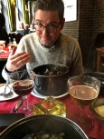Matthew inhales the fragrance of his curried moules, while I try to photograph him through the steam of my own pile of mussels.