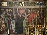 As the story goes, while prepping Jesus for burial, Joseph of Arimathea preserved the blood washed from the Lord's lifeless body. During the Second Crusade (1150), Derrick of Alsace saved Jerusalem from the Muslims and was rewarded with the vial. He carted it home and presented it to Bruges' Bishop (the scene portrayed in this mural). The dried blood suddenly turned to liquid, a miracle that continued to occur every Friday for the next 200 years.