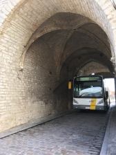 Yep, even city buses barrel through the old gateway.