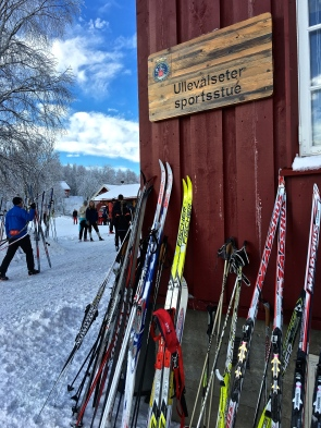 Some folks stack up their skis against the cafe.