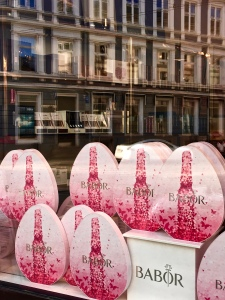 "The windows of every ""frisor"" (hairdresser) and ""salong"" (salon) feature the pink Babor beauty eggs."
