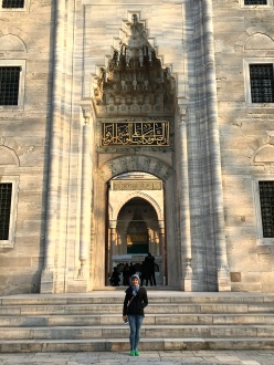 """The fairytale entrance to the mosque's inner courtyard displays a verse from the Quran. Notice the incredible """"stalactites"""" hanging from the Arabesque arch."""
