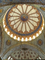 The Blue Mosque's central dome, seen here, was modeled on Hagia Sophia's. It measures 141 feet in height and 110 feet in diameter. While the dome itself is painted, the piers that support it, and the lower-level walls, are covered in tiles from Iznik (ancient Nicea), a city known since Byzantine times for its skill in ceramic painting. The predominantly blue color of these tiles is what gives the mosque its nickname.