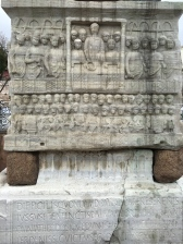 Here, Emperor Theodosius can be seen surrounded by racing fans as he prepares to hand an olive wreath to the winning charioteer. His more practical servant stands by with the real prize -- a sack of coins. The Latin inscription below says it took 30 days to erect the obelisk, but the Greek text on the other side says it took 32.