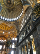 "Before it fell entirely, the Roman Empire split into two parts. The eastern half, ruled by the Greeks, was called Byzantium. Constantinople (Istanbul) was Byzantium's capital city, and Hagia Sophia (meaning ""Divine Wisdom"" in Greek) was its Imperial Church. When Hagia Sophia's patron, Emperor Justinian I, entered the church for the first time, he's said to have exclaimed, ""Solomon, I have surpassed you."" Quite a humble guy, wasn't he?"