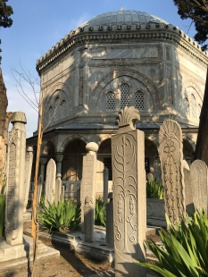 A cemetery surrounds the back yards of the two mausoleums. Each grave has two markers: one holds an inscription while the other is decorative. (In Israel, I was told that the two tombstones confused evil spirits, since they can only enter through the feet -- in other words, which is the headstone and which is the footstone? Demons can't tell.)